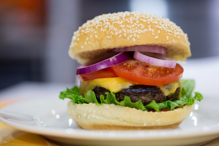 Justin Chapple cooks burgers for National Burger Day