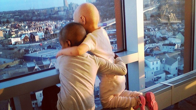 This photo of Madelina DeLuca and Maliyah Jones, embracing while fighting cancer at Children's Hospital of Pittsburgh, has gone viral online.