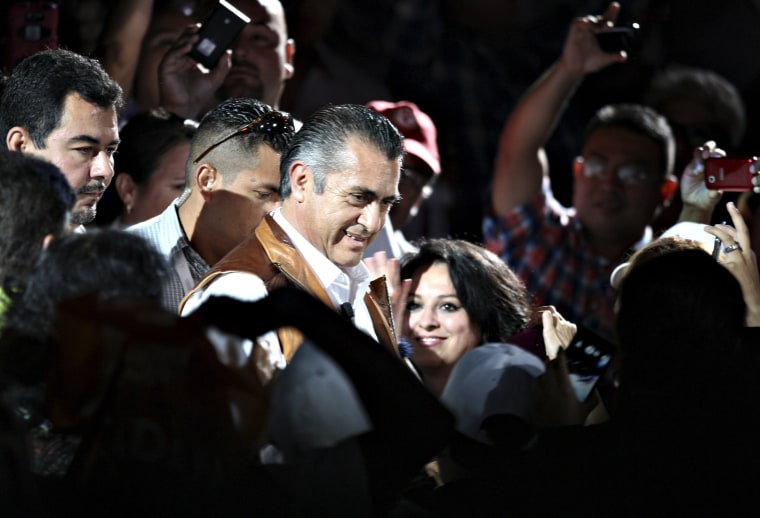 Image: Jaime Rodriguez, independent candidate for governor of Nuevo Leon state, is greeted by supporters during his closing campaign rally in Monterrey