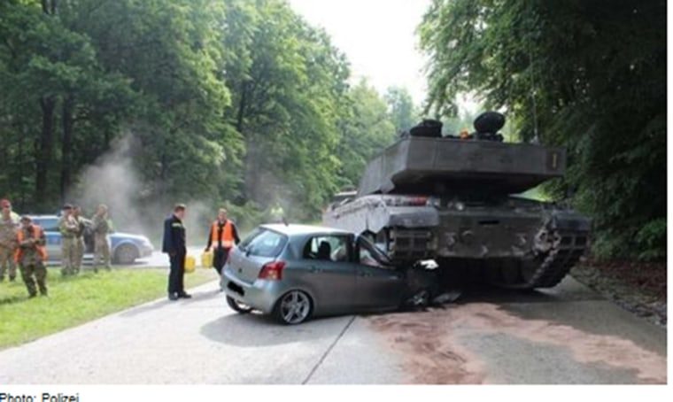 Image: A British army tank drives over car in Augustdorf, Germany