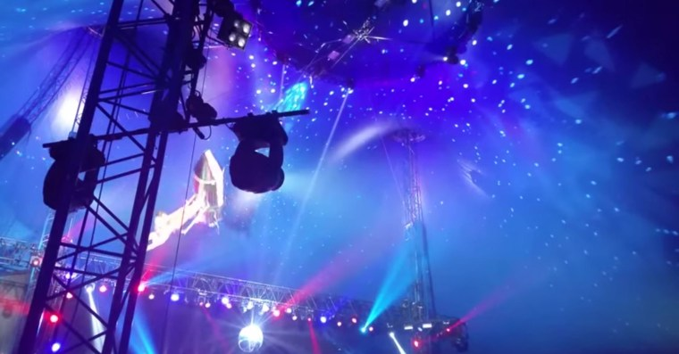 A screenshot of the trapeze artists and their act.