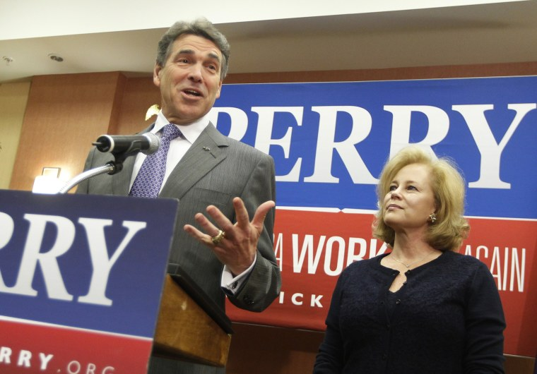 Image: Texas Governor Perry stands with his wife Anita as he announces he is dropping his run for the Republican U.S. presidential nomination during a news conference in Charleston
