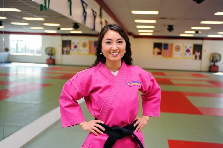 Mimi Hwang in her family's martial arts studio in Louisville, Kentucky.