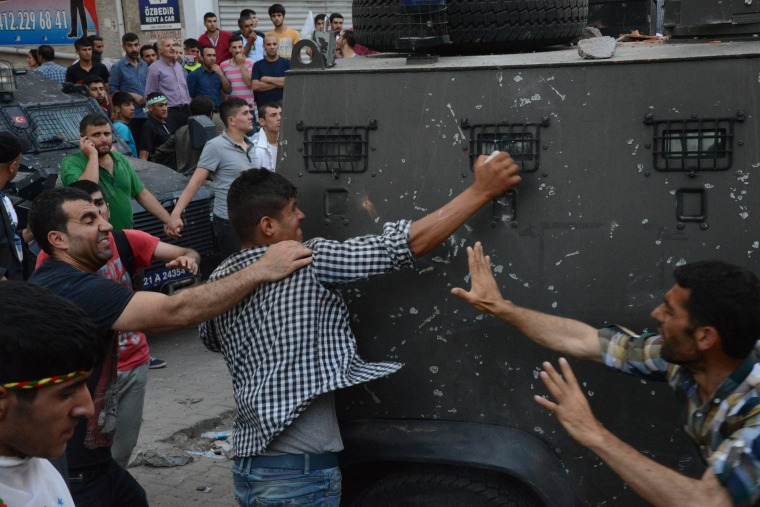 People clash with Turkish police after two successive blasts during a rally by the pro-Kurdish People's Democratic Party (HDP).