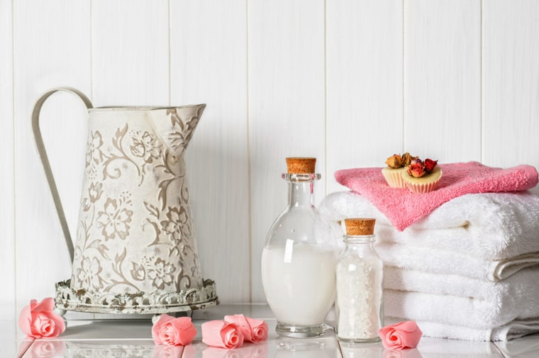 fluffy white towels and pamper items