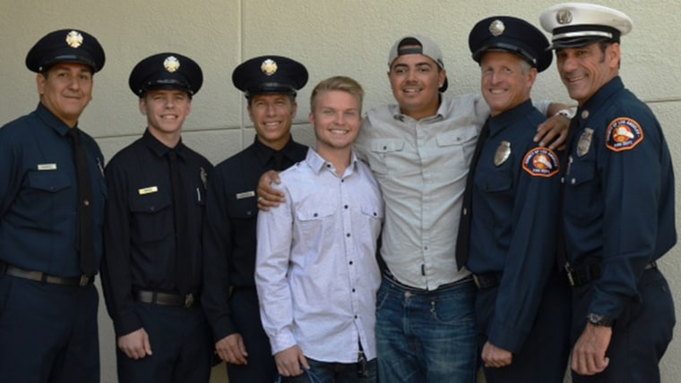 Matt Scalise with paramedics from the Los Angeles County FD and Josh Lucia who who administered CPR until rescuers arrived.