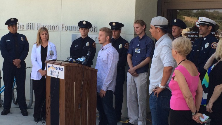Matt Scalise with medical team from Providence Holy Cross Medical Center, rescuers from LAFD and Josh Lucia.