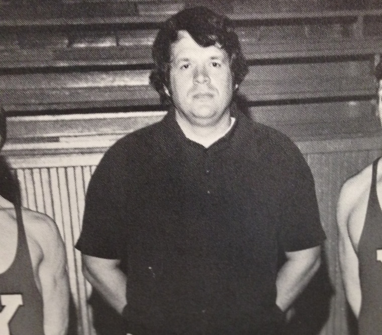 Dennis Hastert, then a wrestling coach, poses with wrestlers in a 1975 Yorkville high school yearbook photo.