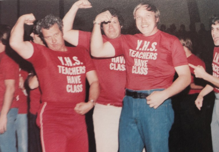 Dennis Hastert poses with wrestlers in a yearbook photo.