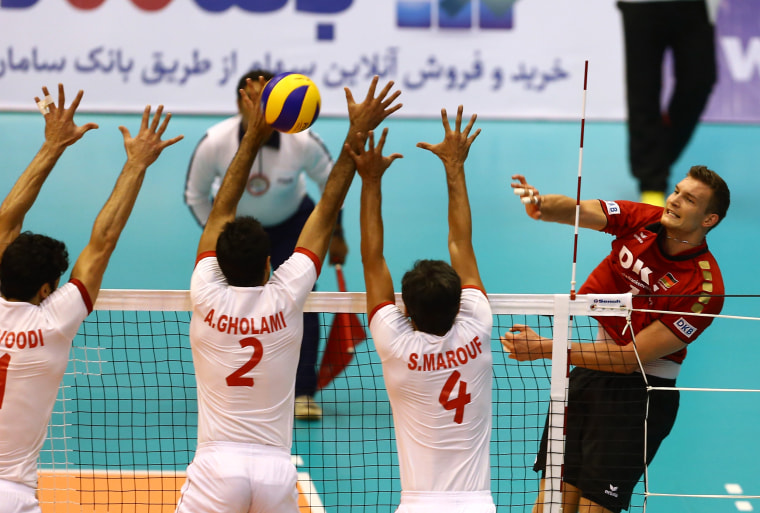 Image: Iran plays a Volleyball World League match against Germany in Tehran on July 12, 2013