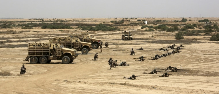 Image: Iraqi, U.S. and Spanish soldiers participate in a training mission outside Baghdad, Iraq, Wednesday, May 27, 2015.