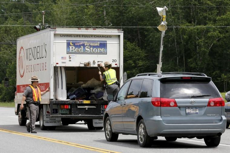 Image: New York State Troopers search a truck at a check point near Dannemora