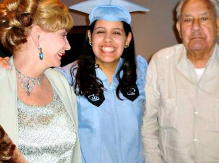 Carmen Cusido with her parents after graduating from Columbia Journalism School in May 2010.