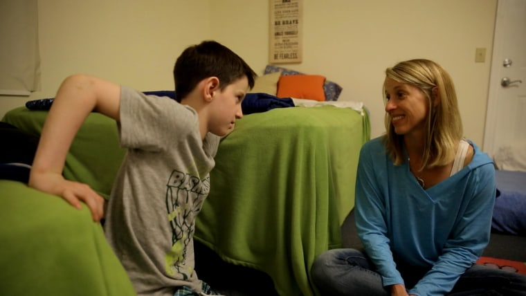 Brady and his mother Kristin inside Brady's room at Camp Sundown in upstate New York.