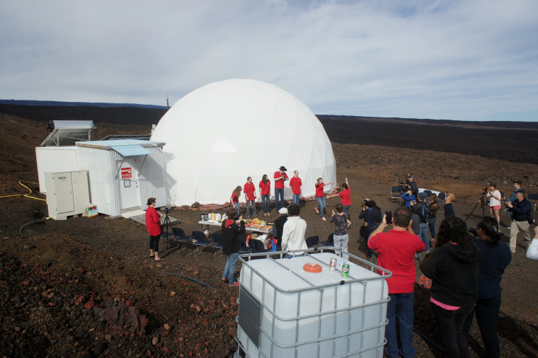 Six scientists exit a dome that they lived in as part of an isolated existence to simulate life on a mission to Mars on the Big Island of Hawaii, Saturday, June 13, 2015.