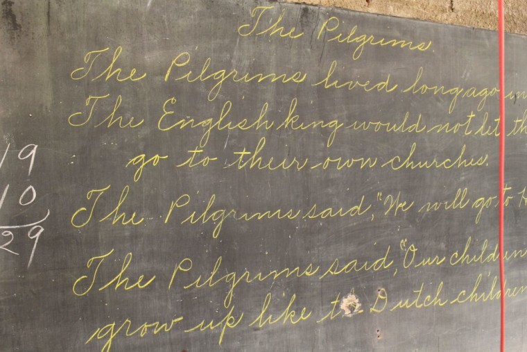 One chalkboard featured a teacher's beautiful cursive writing.