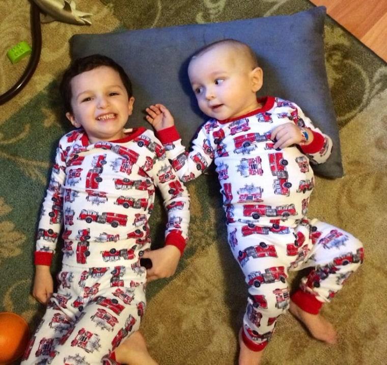 Logan, post-surgery, reunited with his older brother Noah.