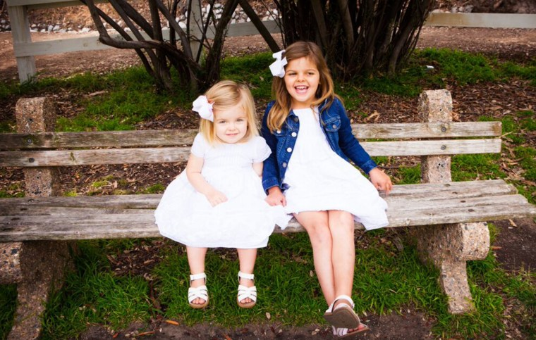 Charlotte Gray, 4, and her 2-year-old sister Gwenyth, who both live with a rare brain condition called Batten disease