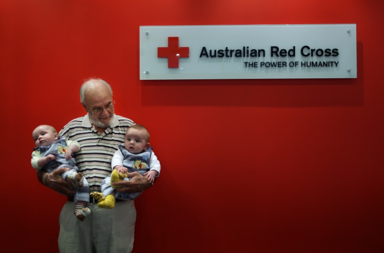 Portrait of James Harrison 72 (centre) with twin boys Seth Murray O+ (left) and Ethan Murray  O-(right) in the Apheresis department at the Australian Red Cross Blood Service. Hundreds of thousands of babies owe their health and in some cases their life to James Harrison as his blood has been used in every dose of anti-D serum since 1967, which is given when the blood types of mothers and babies are incompatible. Red Cross, Sydney, NSW. Today 20th of May, 2009.