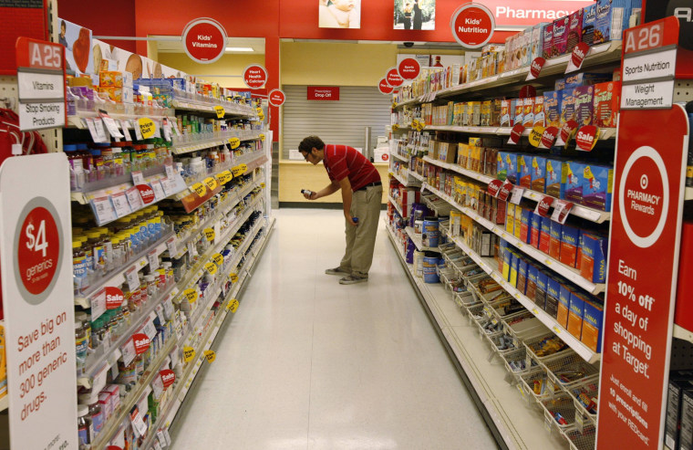 Image: A Target store team member places an item back on the shelf at a Target store in Los Angeles