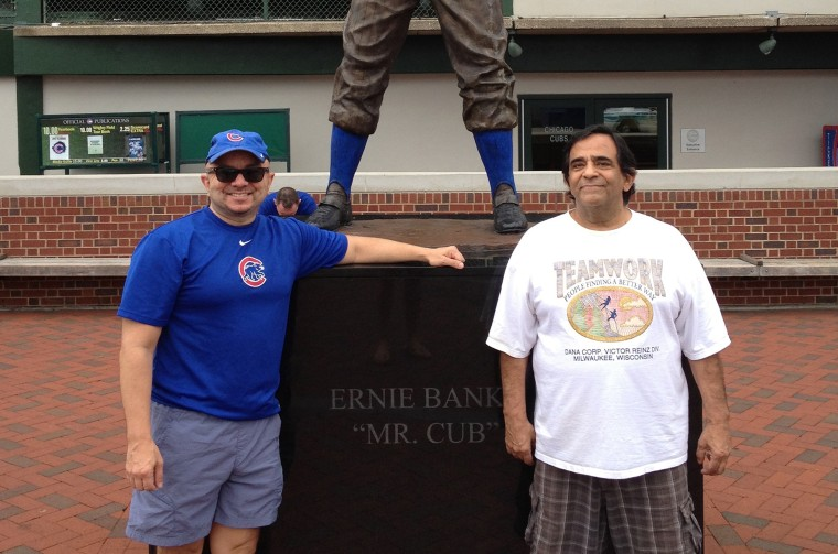 "Larry Gonzalez, a principal at the Raben Group in Washington, D.C., a native of Chicago and a lifetime Cubs fan, with his late father Lorenzo ""Lody"" Guadalupe Gonzalez outside Wrigley Field in one of their last baseball games together."