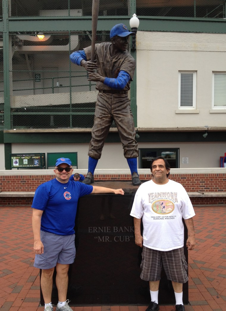 """Caption: Larry Gonzalez, a principal at the Raben Group, a native of Chicago and lifetime Cubs fan, with his late father  Lorenzo """"Lody"""" Guadalupe Gonzalez outside Wrigley Field in one of their last baseball games together.   Credit: Larry Gonzalez."""