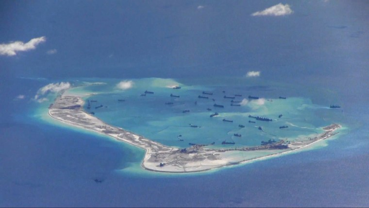 Image: File still image from United States Navy video purportedly shows Chinese dredging vessels in the waters around Mischief Reef