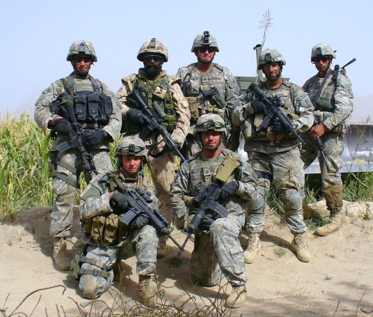 """This is a photo of Lt.Col. Harjit Singh Sajjan of the Canadian army in a group with U.S. soldiers before they embarked on a strategic mission. He was deployed to Afghanistan thrice, the third time at the request of Gen.James Terry of the U.S. army, who was the commander of the 10th Mountain Division stationed in Afghanistan at that time. Col.Sajjan served as """"Special Adviser"""" to Gen.Terry. He was a vital part of some strategic missions carried out by the U.S. army in Kandahar, and other areas heavily controlled by the Taliban. In addition to serving as """"Special Adviser"""" to Gen.James Terry, he also served as Special Adviser to another U.S. govt. representative in Kandahar."""