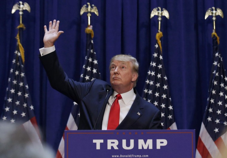Image: U.S. Republican presidential candidate Trump waves as the crowd cheers after he said he is going to run for the 2016 Republican presidential nomination at Trump Tower in New York