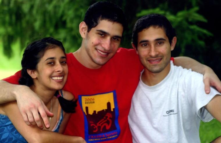 A picture of Sangeeta Tripathi, Sunil Tripathi, and Ravi Tripathi (left to right).