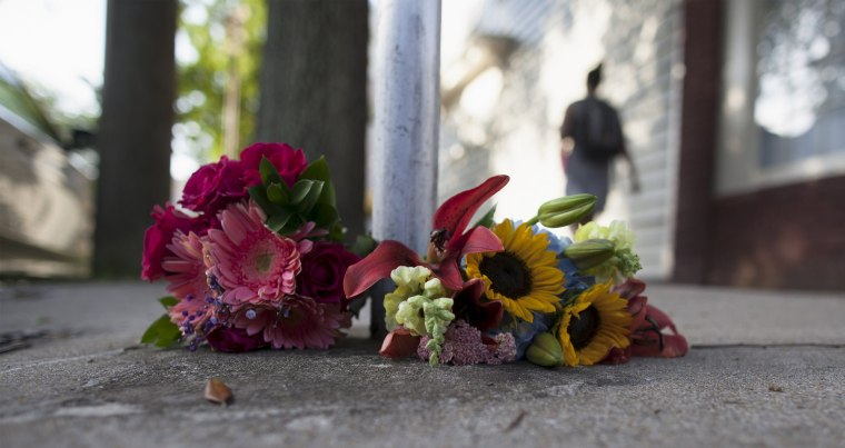 Image: Flowers for the victims of Wednesday's shootings, are laid near a police barricade in Charleston, South Carolina