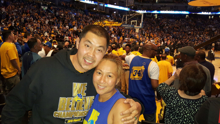 Paul Wong with his wife, Mai, at Oracle Arena, attending the viewing party for Game 6 of the NBA Finals.