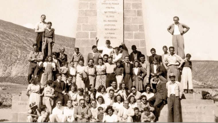 Members of Ecuador's Jewish exile community pose at the Equatorial monument in the 1940s.