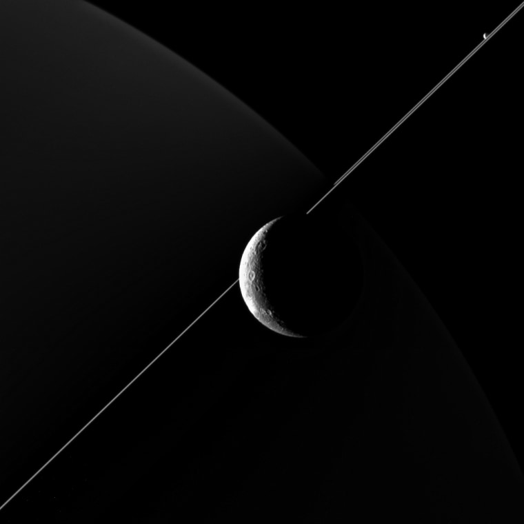 NASA's Cassini Probe Captures Stunning Views of Saturn's Moon Dione
