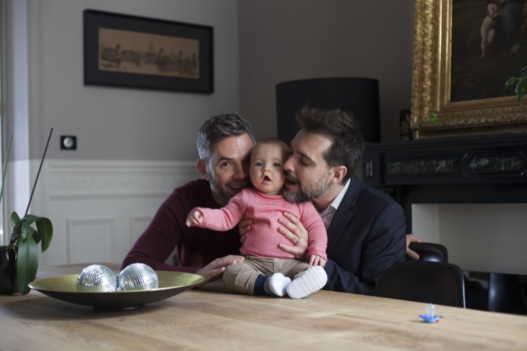 """Eric and Jeremie, Brussels, Belgium: Eric: """"Becoming a father has made me even more human, giving more meaning to the statement 'I am part of the human community before being part of the gay community'. I am proud to be gay, but I am even prouder to be a daddy and (future) husband of Jérémie."""""""
