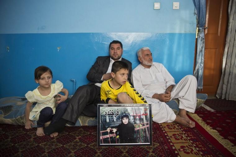 Image: Mohammad Nader Malikzada, 72, right, father of Farkhunda Malikzada, and his son, Najibullah Malikzada