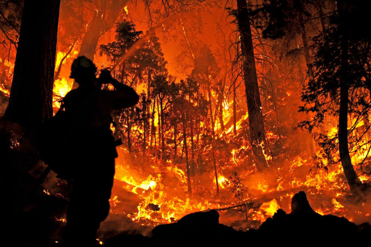 IMAGE: Firefighters battle the Lake Fire in California