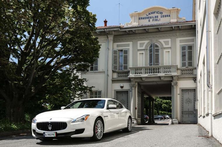 A Maserati Quattroporte sits outside Zegna headquarters.