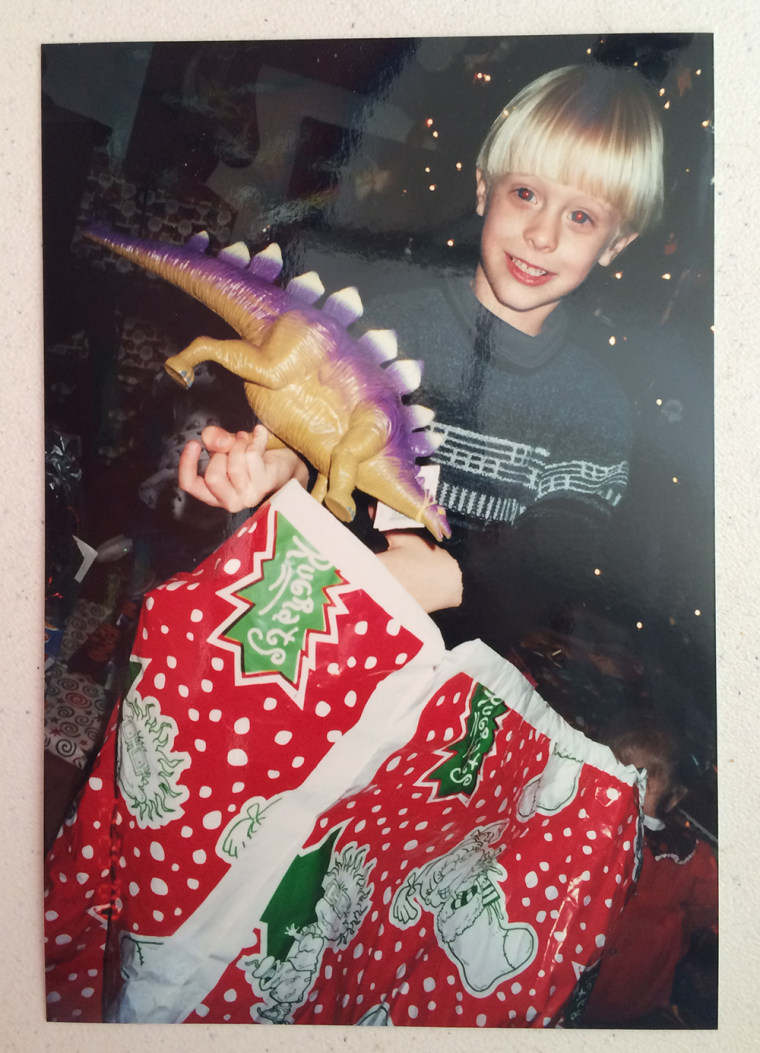 Dylann Roof opens a Christmas present in a family photo.