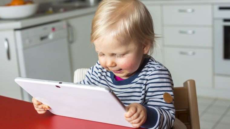 Toddler using a tablet.