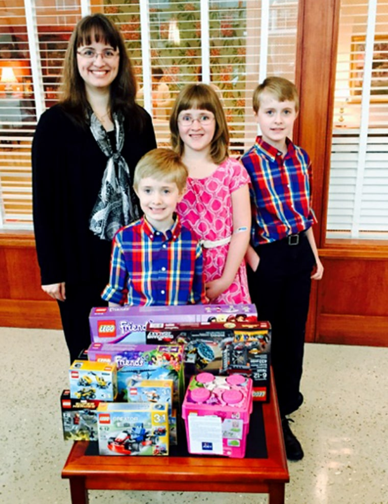 Abby Grubbs gives away toys to sick children.