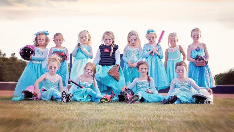 Tee ball team takes team photo in Elsa dresses