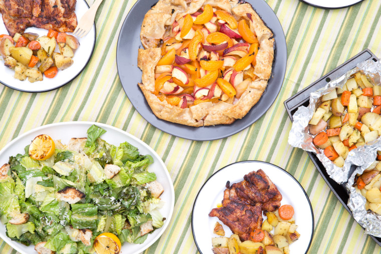 Grill a whole meal: BBQ Chicken Thighs; Grilled Fruit Tart; Roasted Root Vegetable Packets; Grilled Caesar Salad