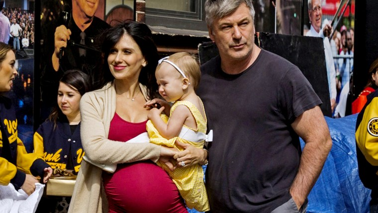 """Image: Alec and Hilaria Baldwin arrive with their daughter Carmen at Ed Sullivan Theater in Manhattan as David Letterman prepares for the taping of tonight's final edition of """"The Late Show"""" in New York"""