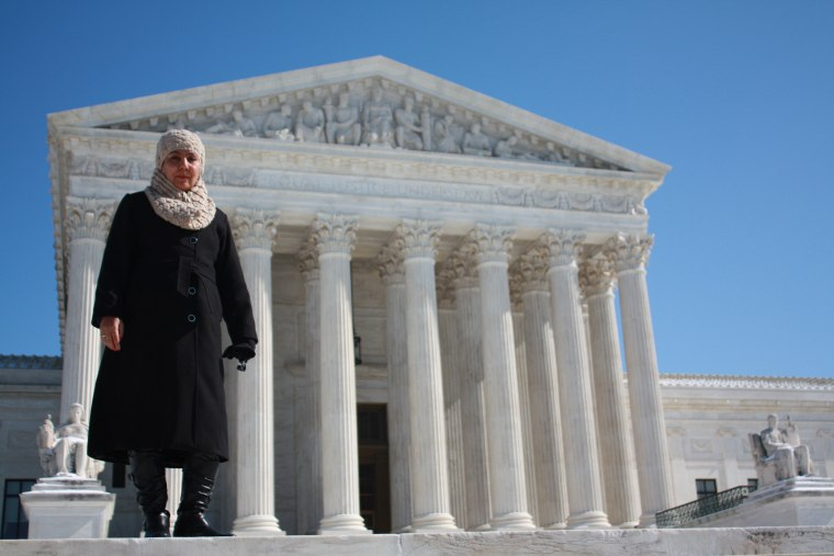 Fauzia Din stands outside the Supreme Court which heard her case Kerry v. Din on Feb. 23 in Washington, D.C.
