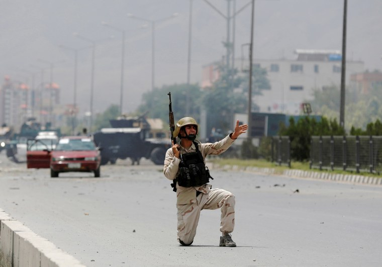 Image: Member of Afghan security forces shouts orders
