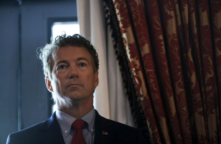 """Image: Republican presidential candidate Senator Rand Paul (R-KY) waits before addressing a legislative luncheon held as part of the \""""Road to Majority\"""" conference in Washington"""