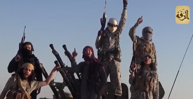 Image: ISIS fighters celebrate capture of Syrian Army Base 93 in August 2014