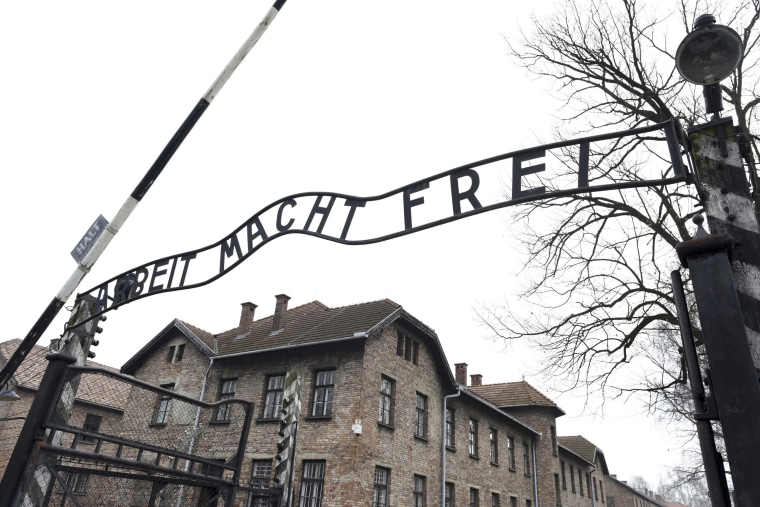"""Image: File photo of the sign """"Arbeit macht frei"""" at the main gate of the former German Nazi concentration and extermination camp Auschwitz in Oswiecim"""
