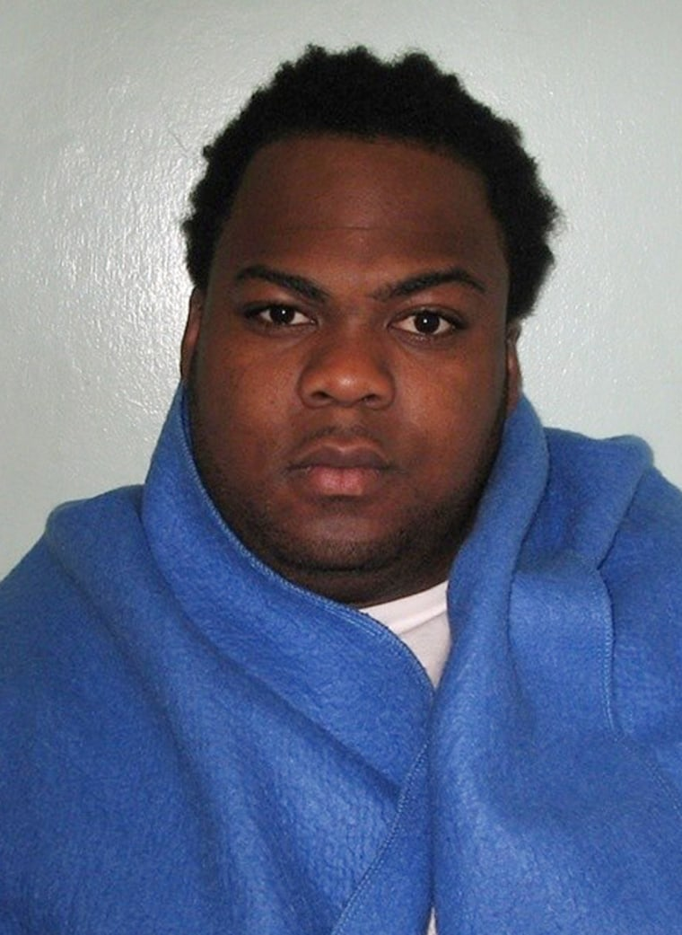 Image: A Metropolitan Police handout photo shows the custody photograph of Nicholas Salvador after his arrest in London.